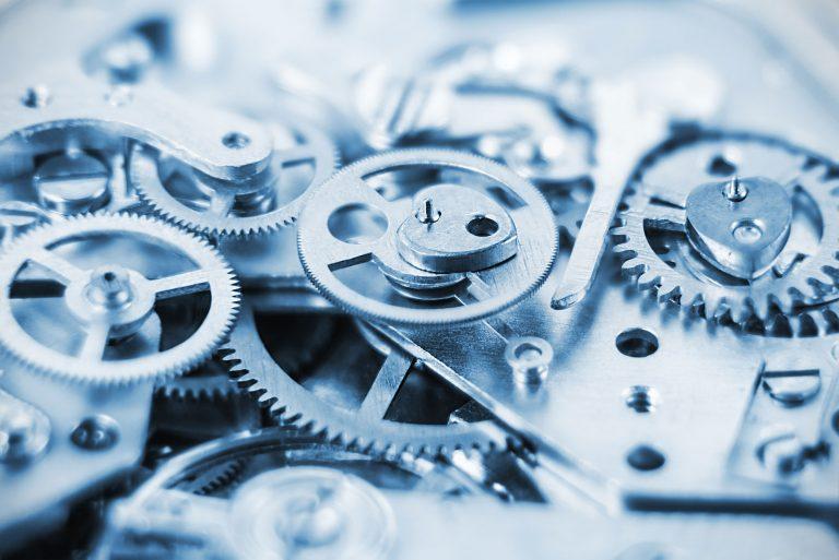 Kugghjul i blått ljus som visar att med Energy Sourcing Tools automatiseras uppgifterna kring ditt elinköp och du får kontroll över elmarknaden